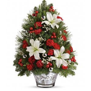 This festive Christmas tree delivers a warm holiday hello! A spirited way to send your best holiday wishes, this arrangement of lilies, limonium, carnations and pine is trimmed with sparkling silver ornament balls that perfectly complement its stunning etched mercury glass vase.