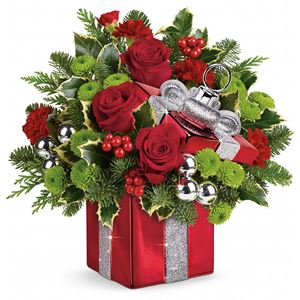 Shimmer and shine! Make the holiday sparkle with a stunning bouquet of red roses, bright green mums and festive holly, hand-delivered in a shimmering ornament box. With bold red and silver glitter details, this is the perfect addition to any holiday d&eacut;cor!