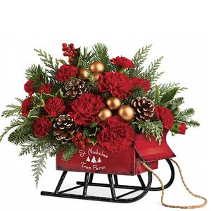 Delivered in a rustic metal sleigh, this lush mix of fresh flowers and winter greens delivers classic Christmas style!