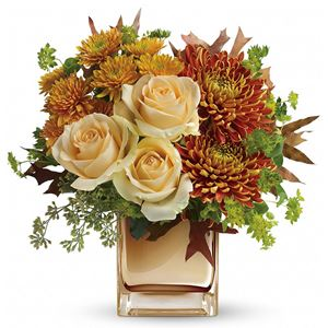 This elegant bouquet features creamy peach roses, gold cushion chrysanthemums, bronze disbud chrysanthemums, bupleurum, seeded eucalyptus and oak leaves. Delivered in an exclusive bronze Mirrored Cube vase.