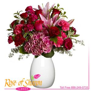 Make a lovely lady blush with a generous mix of wine-hued blossoms such as roses, hydrangea, Asiatic lilies and more, in rich shades of burgundy, red and pink mixed with a touch of fragrant eucalyptus, and delivered in a simple glass vase. With over half a dozen different varieties of flowers, It's a colorful and rare bouquet for any occasion. We will select the freshest available blooms to re-create the look and feel of this arrangement so contents may vary. Shown in standard glass vase.