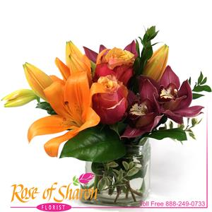 A small arrangement with big style made possible by the premium orchids and Cherry Brandy Roses.