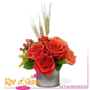 Miki Autumn Bouquet is a fresh collection of bright, long-lasting roses and dianthus, hypericum and wheat if bright autumnal tones. Small and delightfully delivering your gift of thanks, concern or joy.