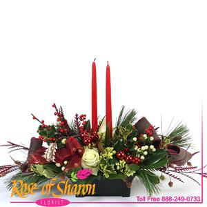 Reagan is a tradional table centerpiece of holly and Ilex, roses and evergreens.