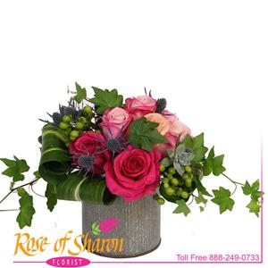 Rosabela is a beautiful assortement of 8 roses in tones of pink. Arranged in our corragated tin vase, this beautiful bouquet dazzles with texture and tone. See Rosana to change the container.